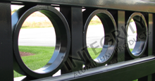 Ornamental Circle Option Installed Between Black Aluminum Picket